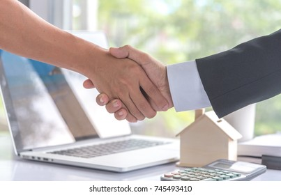 Good deal, two business people shaking hands ofter contract signature, concept of estate agent and customer, housing purchase and insurance