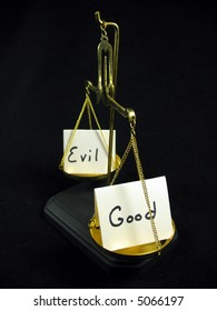 Good and evil cards on a gold scale.
