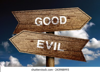 Good Or Evil concept road sign with blue sky background.
