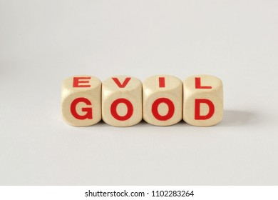 Good and Evil written with wooden cubes