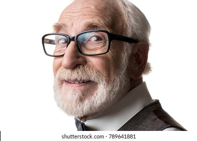 Good eyesight. Close up of mature male face in framed glasses looking at camera with joy. Isolated on background
