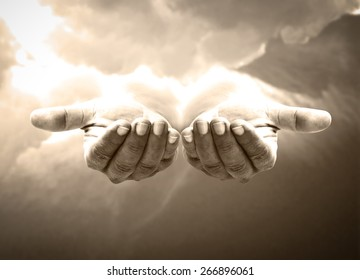 Good friday concept: Jesus Christ open empty hands with palm up on heaven background