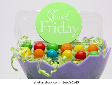 Good Friday Eggs A 'Good Friday' sign placed on bright colored eggs, which are placed on green shredded paper in a purple bowl.