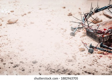 Good Friday, Passion of Jesus Christ. Crown of thorns, hammer, bloody nails on ground. Christian Easter holiday. Top view, copy space. Crucifixion, resurrection of Jesus Christ. Gospel, salvation