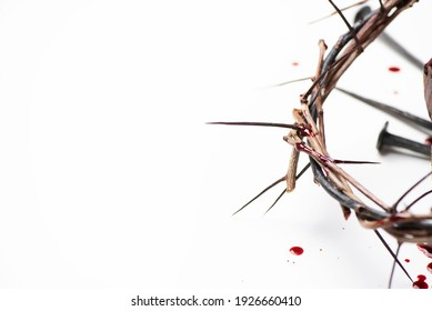 Good Friday, Passion of Jesus Christ. Crown of thorns, hammer, old nail isolated on white. Christian Easter holiday. Top view, copy space. Crucifixion, resurrection of Jesus Christ. Gospel, salvation.