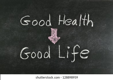 """good health and good life"" word written on blackboard"