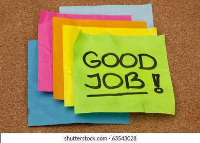 good job - congratulation, a stack of colorful sticky notes on cork bulletin board