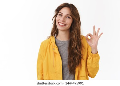 Good job. Pretty carefree modern stylish caucasian girl long chestnut hair show okay ok approval sign smiling toothy tilting head pleased give positive reply like excellent service, white background