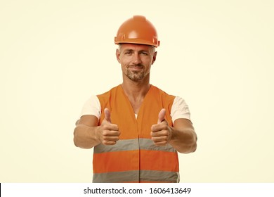 Good job. Safety is main point. Man builder wear protective hard hat and uniform white background. Worker builder confident looking camera. Protective equipment concept. Strong handsome builder.