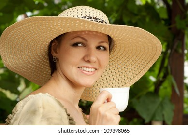 Good lady sitting at a table on the veranda