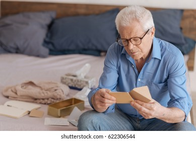Good looking aged man reading a note