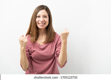 Good looking brunette woman looking excited about her success and some great news