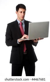 A good looking businessman using his laptop against white background