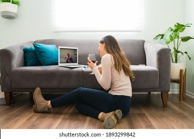 Good looking couple in a long-distance relationship is laughing and having a good time during a romatic online date