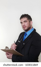 good looking doctor standing looking at camera