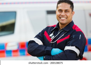 good looking male ambulance staff with arms crossed