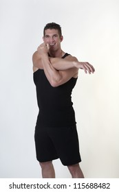 good looking male bodybuilder doing some stretching exercises before his does his daily workout