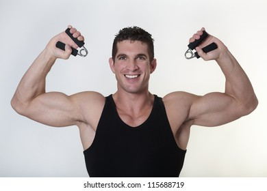 good looking male bodybuilder using hand gripper