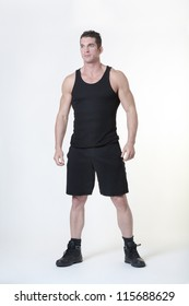 good looking man standing wear gym clothes about to do a work out
