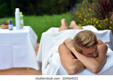 a good looking man waiting for a massage lying down