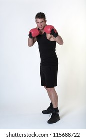 good looking man wearing boxing gloves and working out