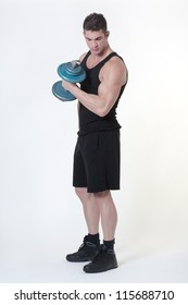 good looking man who works out each day and has a fit body lifting weights