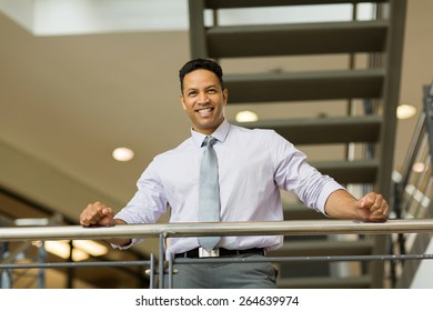 good looking mid age corporate worker in modern office