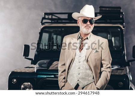 Good Looking Senior Man Wearing Formal Fashion with White Cowboy Hat and  Sunglasses f084a2f943d0