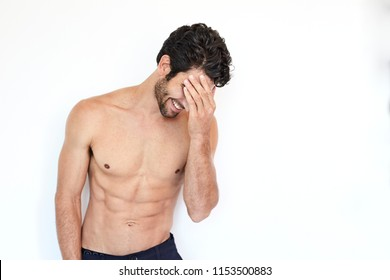 Good looking shirtless guy laughing