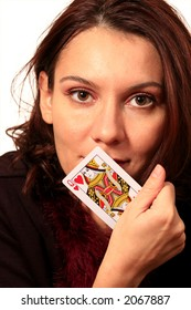 Good looking woman showing a dame card
