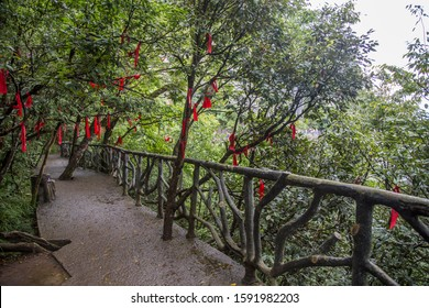Good luck and prayer ribbons tied to trees above the walkway on Tianmenshan (mount tianmen) located in the city of Zhangjiajie, Hunan province China.