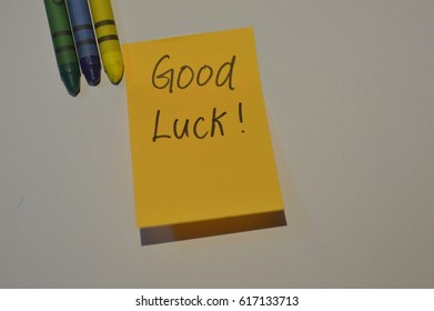 """""""Good luck"""" sticky note with white background and crayon colour ."""