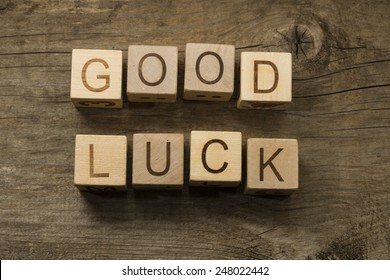 Good Luck text on a wooden cubes