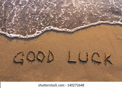 good luck, words written on the beach