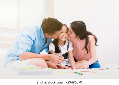 Good mental health for Happy family;  father, mother and little girl on the bed at home, Asian happy loving family. Soft and select focus.