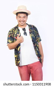Good mood young man in hawaiian costume giving thumbs up isolated on white background.