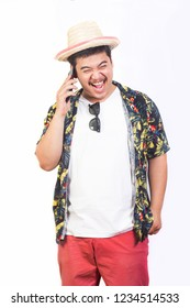 Good mood young man in hawaiian costume talking on the phone received travel isolated on white background.