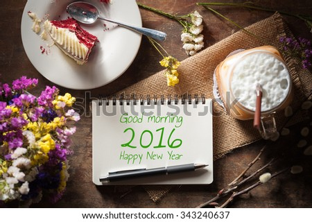 good morning 2016 happy new year is written on notepad with pen a