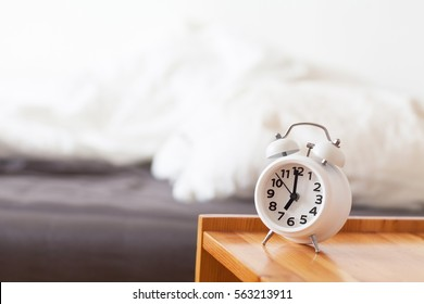 Good morning with alarm clock on bedside table. Life in schedule concept. Easy awakening in light interior