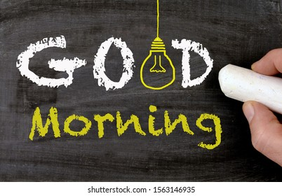 Good morning chalkboard, lightbulb and a hand