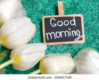 good morning chalkboard with white tulips on grey background
