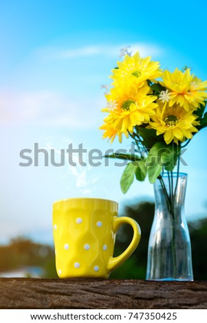 Good morning coffee yellow flower vase stock photo edit now good morning coffee and yellow flower vase on a wooden table in the sunrise sky background mightylinksfo