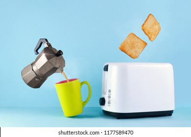 Good morning concept. A cup of hot, fresh coffee, a coffee maker and roasted toast bread popping up of toaster on a blue background. Wake up early in the morning for a delicious breakfast.