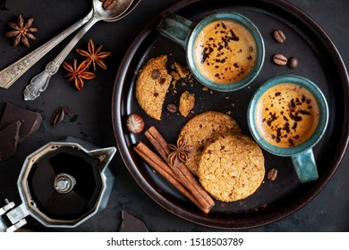 Good morning or Have a nice day concept with two cups of frothy coffee served with cookies for breakfast. Flat lay with copy space for your text