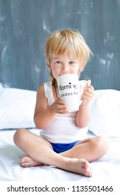 Good morning honey. Cute boy with cup of tea. Handsome boy