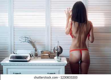 Good morning. Morning sexy woman waking up, relaxed. Red lingerie on nacked girl. Safety sex and condom protection