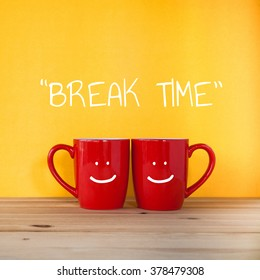 Good morning word. Two cups of coffee and stand together to be heart shape on yellow background with smile face on cup.