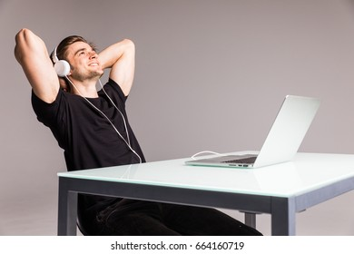 Good music increases my productivity serious young man in headphones working on laptop