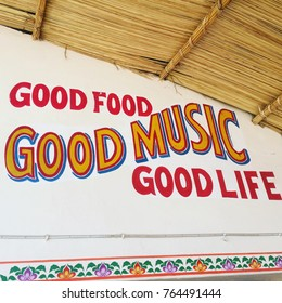 Good music life food sign on wall