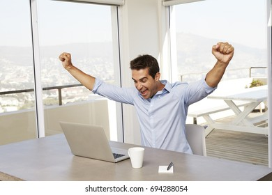 Good news for cheering man using laptop